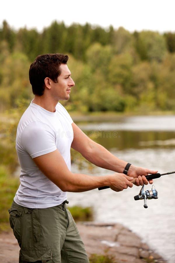 Homme de pêche image libre de droits