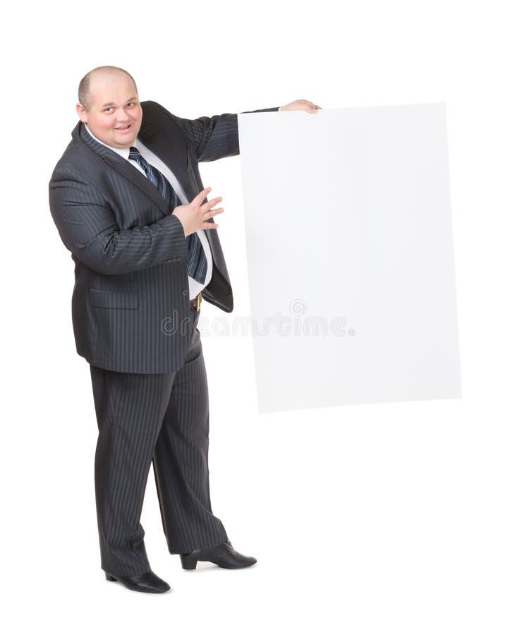 Homme De Poids Excessif Gai Avec Un Signe Blanc Photo stock