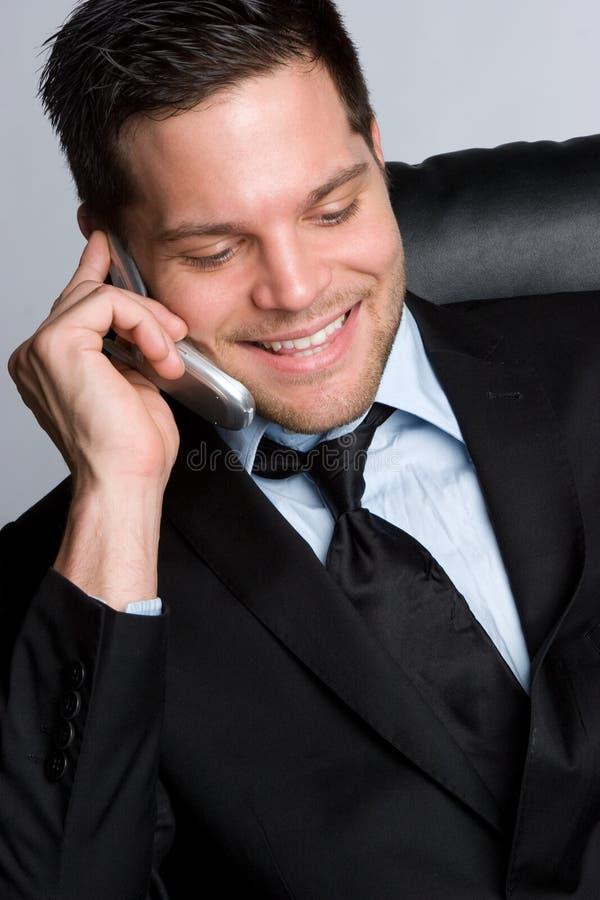 Homme de sourire de téléphone photo libre de droits
