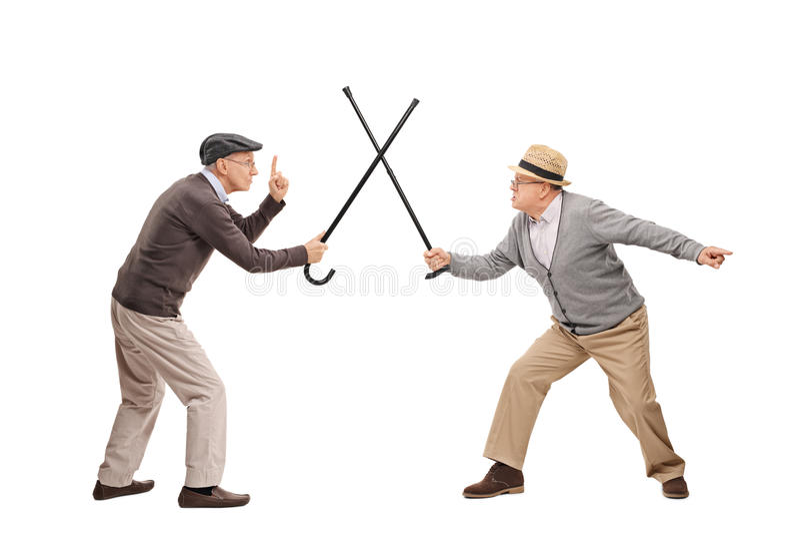 Homme deux supérieur dans un combat d'épée avec des cannes image stock