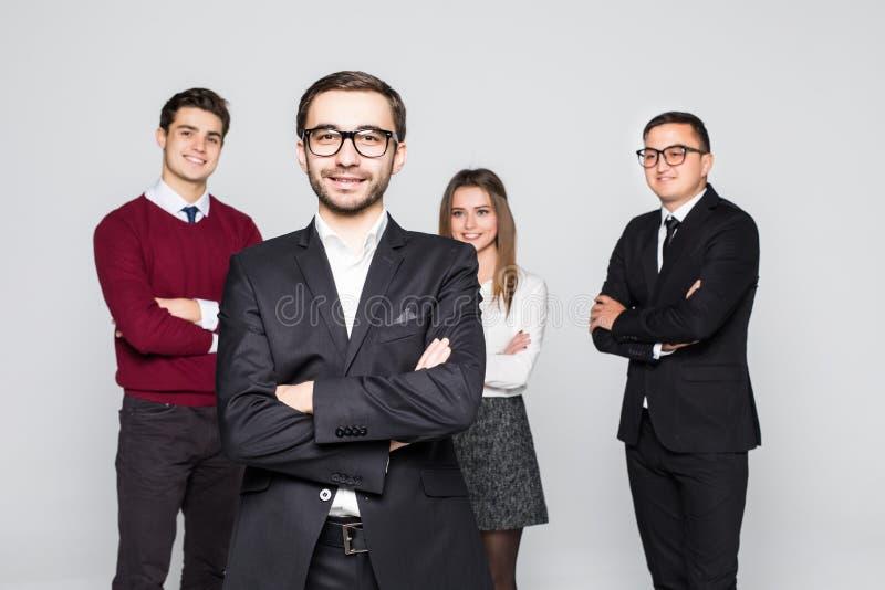 Homme devant le groupe d'équipe de gens d'affaires d'isolement au-dessus du fond blanc photos libres de droits