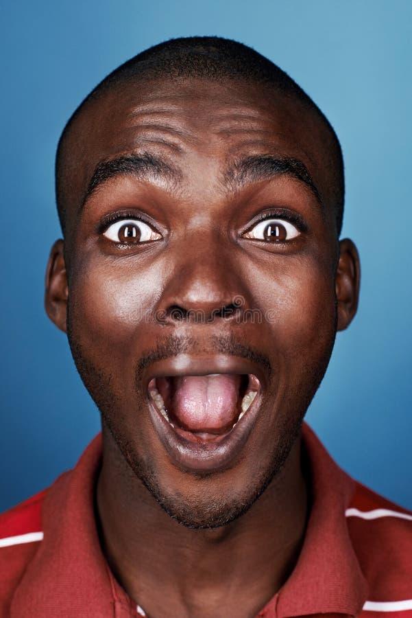 Assez Homme Drôle D'Africain De Visage Image libre de droits - Image  DX43