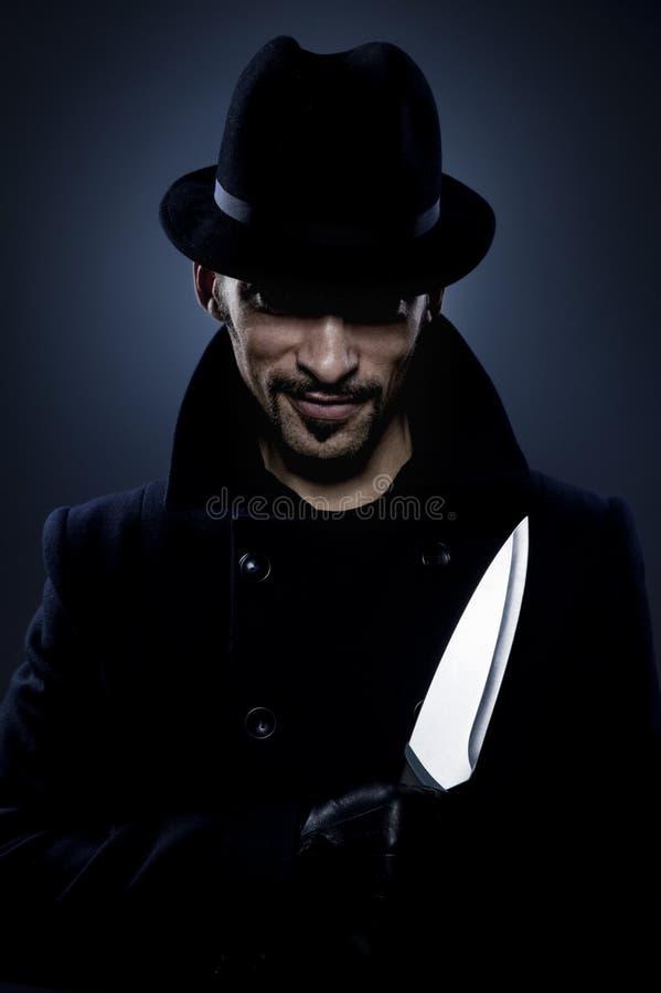 Homme effrayant avec un couteau image libre de droits