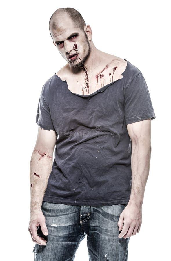 Homme effrayant et ensanglanté de zombi photographie stock