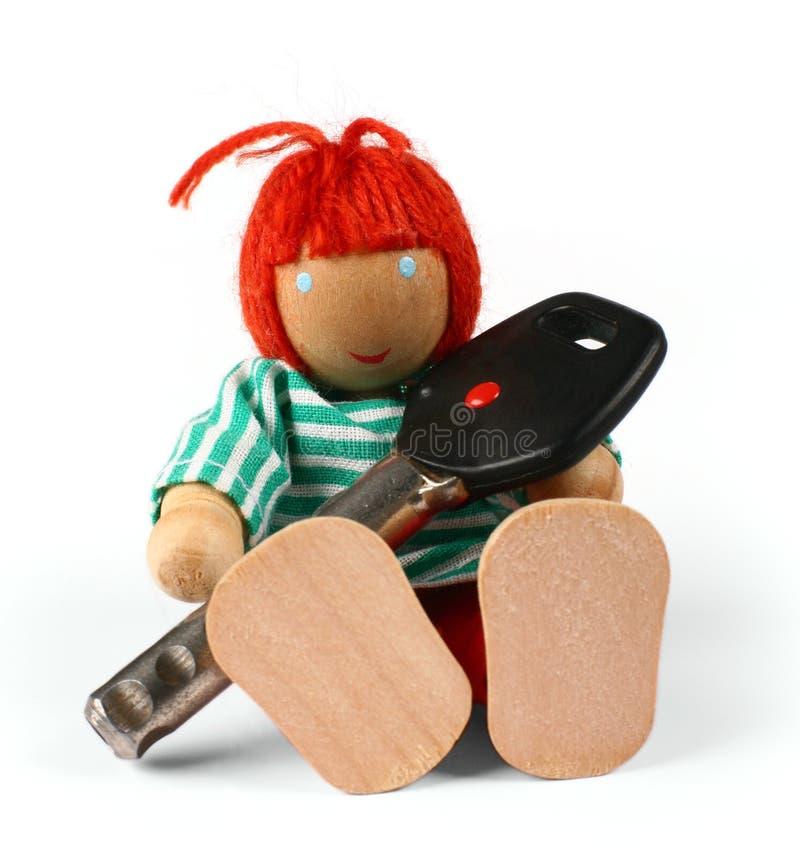 Homme en bois avec la clé image libre de droits