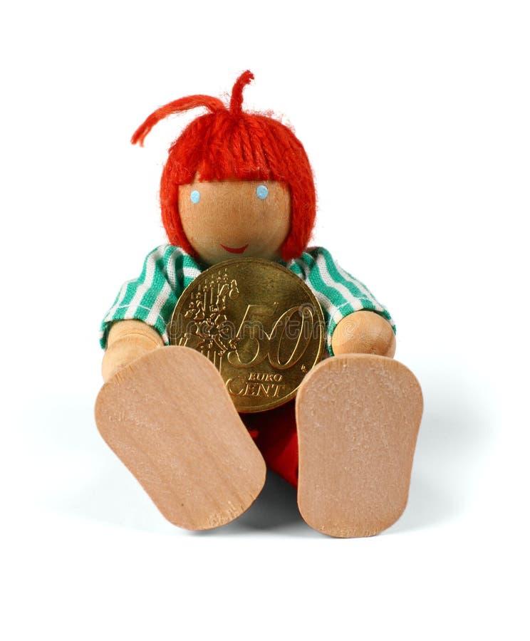 Homme en bois avec la pièce de monnaie. photos stock