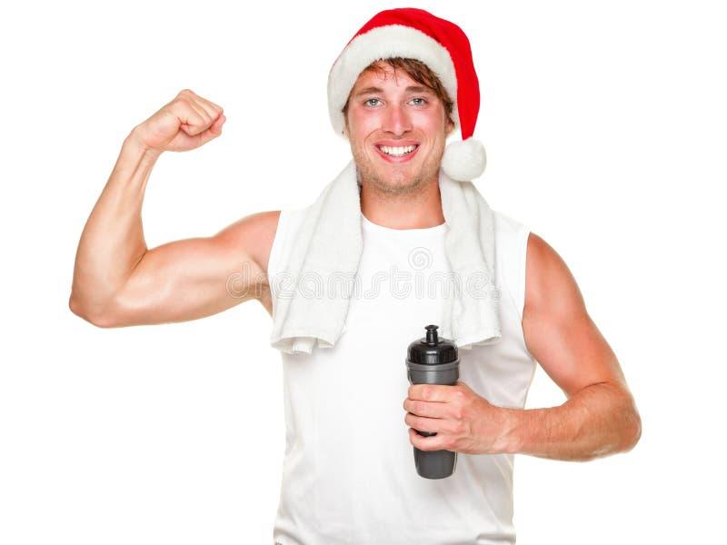 Homme en bonne santé d'exercice de Noël affichant des muscles photo libre de droits