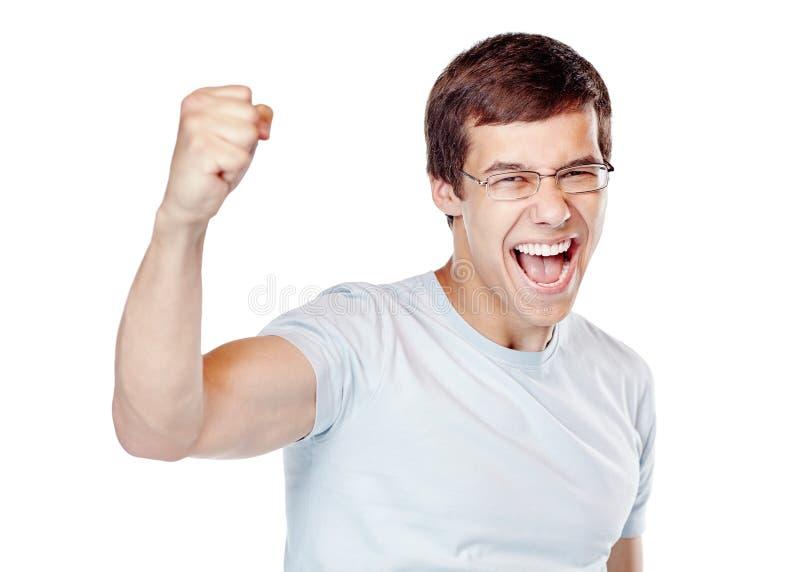 Homme enthousiaste célébrant la victoire images libres de droits