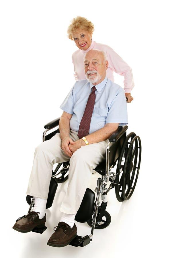 Homme et épouse handicapés aînés images stock
