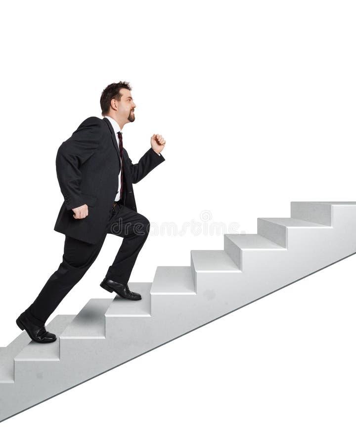 Homme et escaliers d'affaires image stock