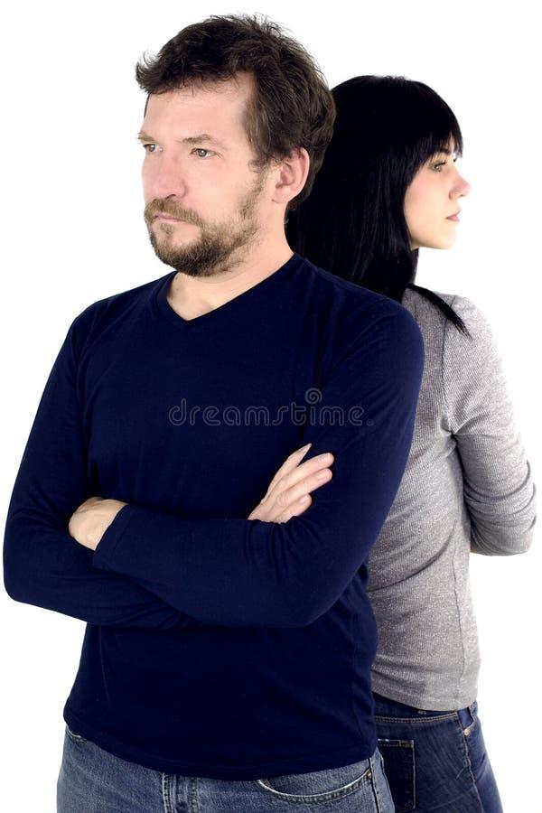 Homme et femme de nouveau à fâché arrière photographie stock libre de droits