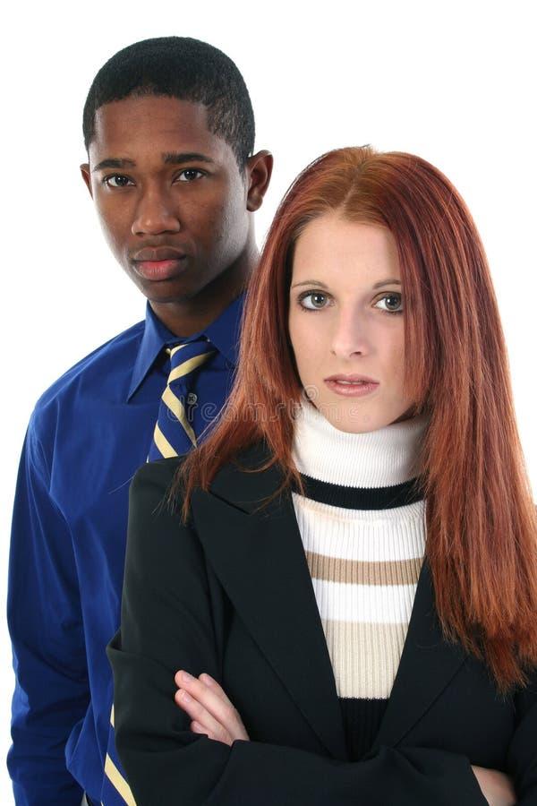 Homme et femme sérieux d'équipe d'affaires photographie stock