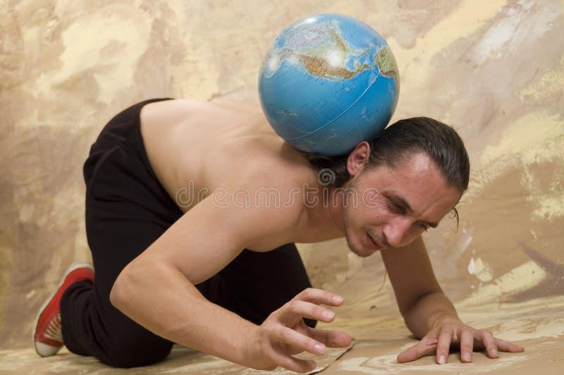 Homme et globe image stock