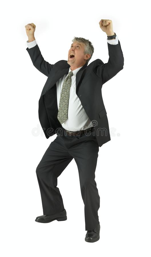 Homme extrêmement heureux dans le costume souriant avec des bras augmentés victorieusement photographie stock libre de droits