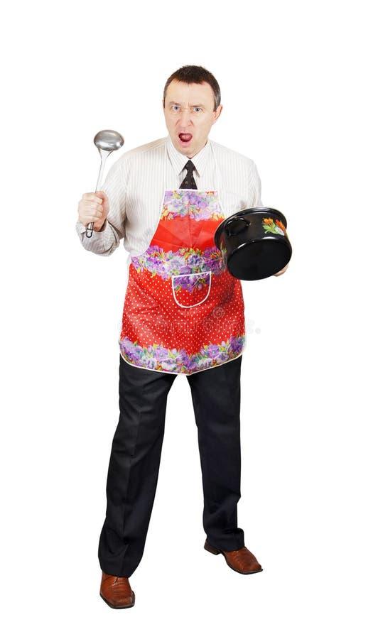 Homme fâché avec des accessoires de cuisine images stock