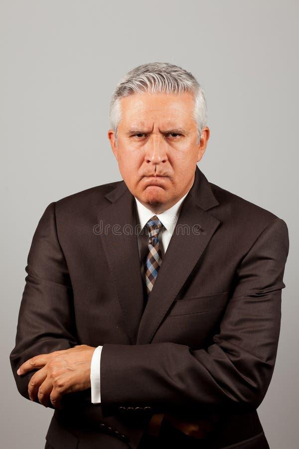 Homme fâché d'affaires image stock