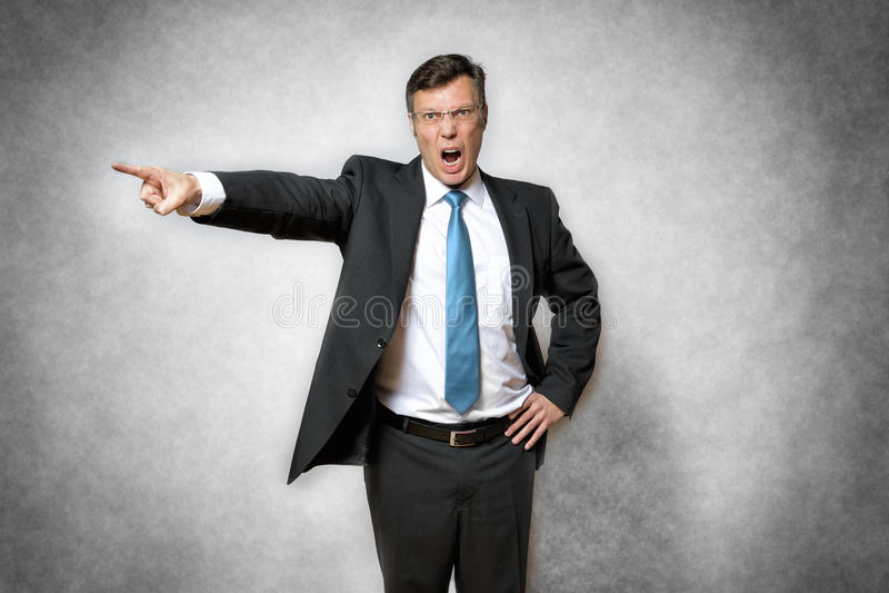 Homme fâché d'affaires photo libre de droits