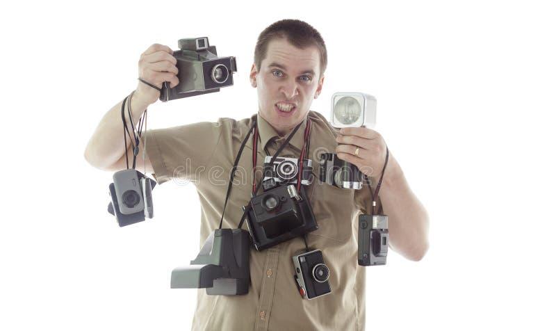 Homme fâché et bouleversé prenant des photos dans le studio image stock