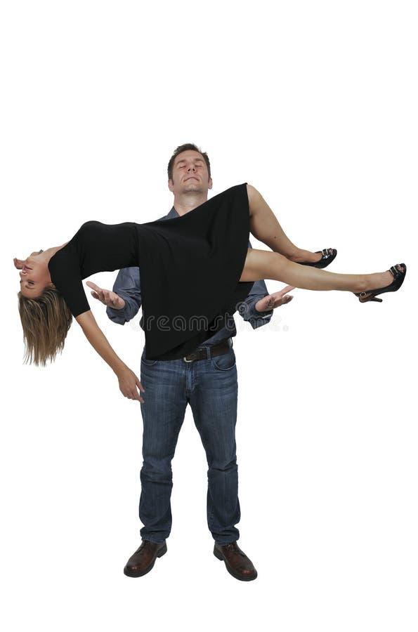 Homme faisant de la lévitation une femme photo stock