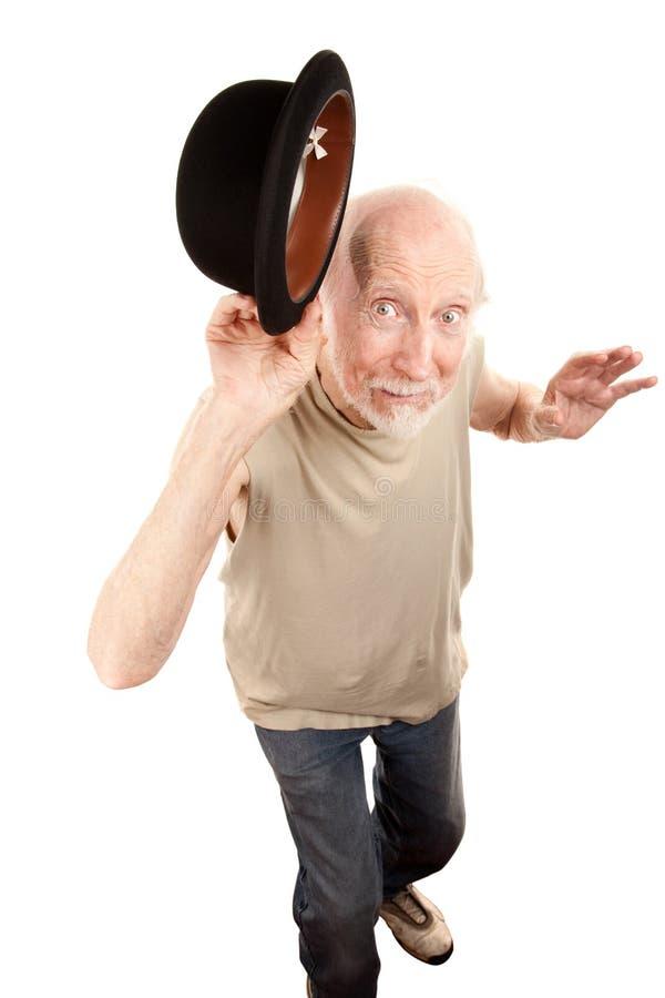 Homme fol de danse avec le chapeau de chapeau melon photographie stock