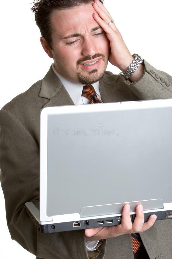 Homme frustrant d'ordinateur portatif photo stock