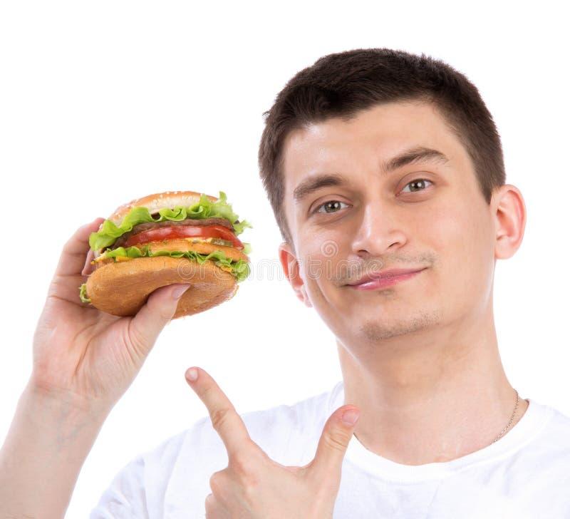 Homme heureux avec le sandwich malsain savoureux à hamburger d'aliments de préparation rapide images libres de droits