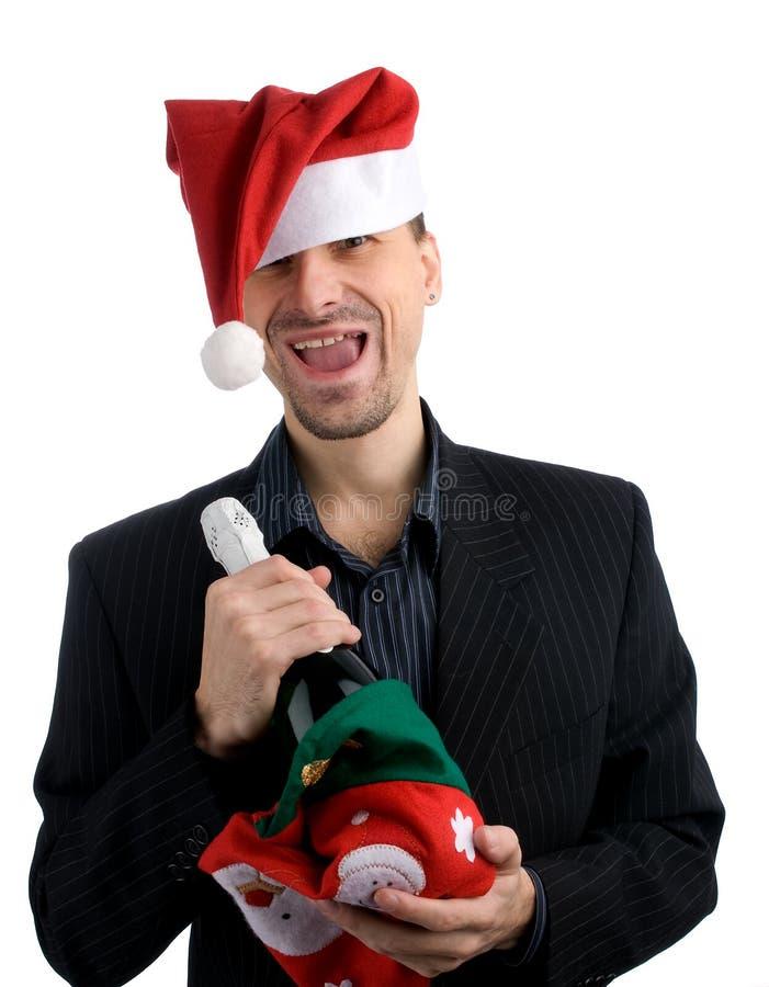 Homme heureux d'affaires dans un chapeau de Noël photographie stock libre de droits