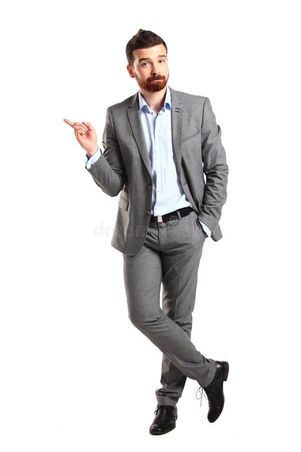 Homme heureux d'affaires présent et montrant image libre de droits