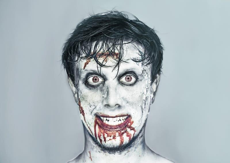 Homme heureux de zombi photographie stock libre de droits