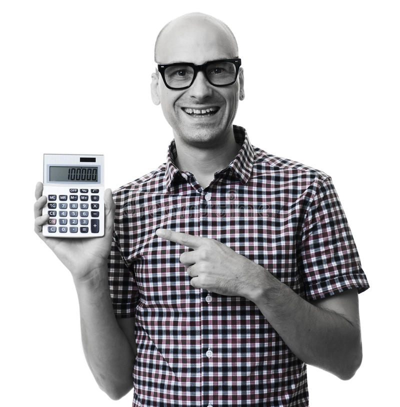 Homme heureux indiquant la calculatrice D'isolement image stock