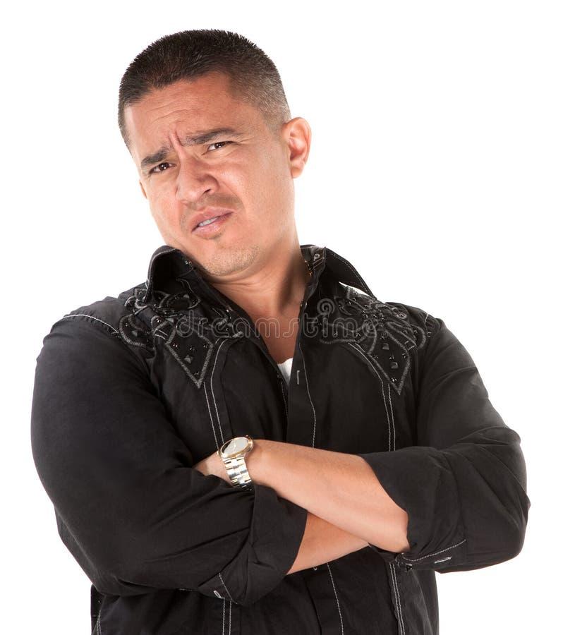 Homme hispanique soupçonneux photographie stock
