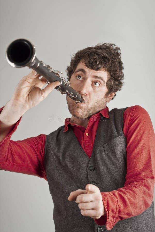 Homme idiot de clarinette images libres de droits