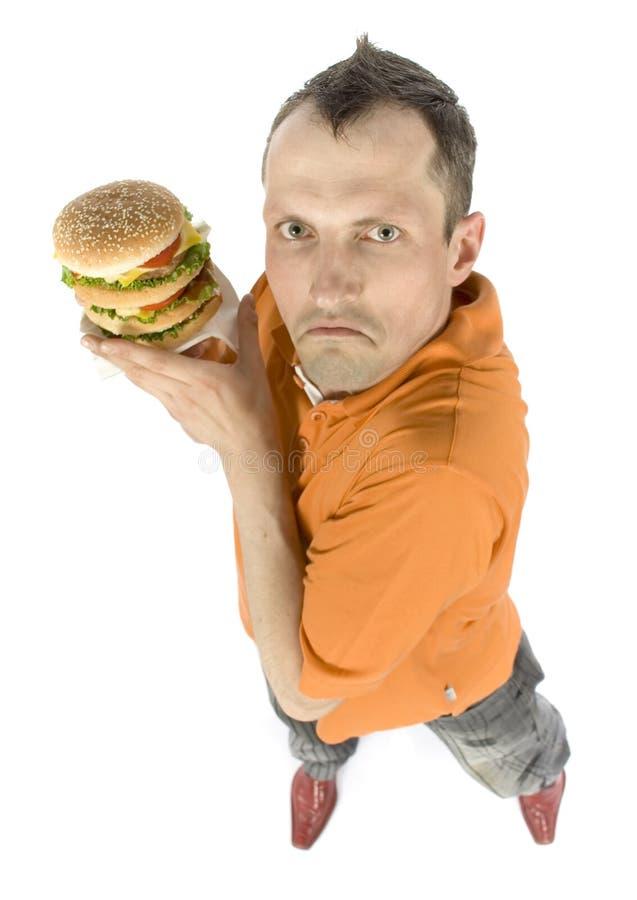 Homme jaloux avec l'hamburger photos libres de droits