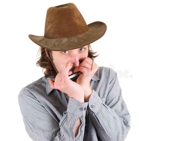 Homme jouant l'harmonica photo libre de droits