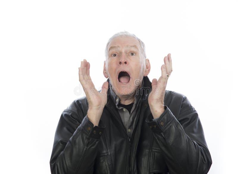 Homme mûr avec l'expression du choc photo stock