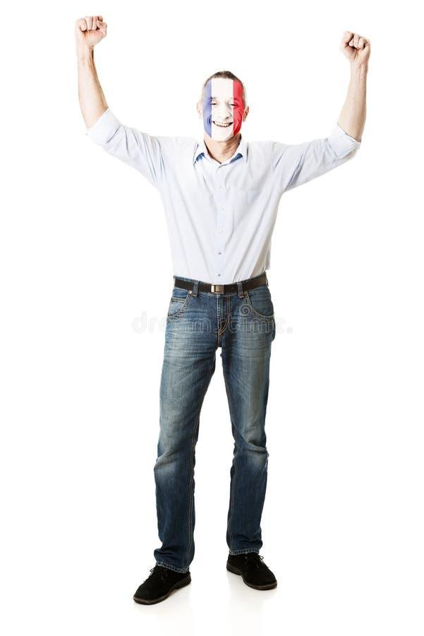 Homme mûr avec le drapeau de Frances sur le visage image libre de droits