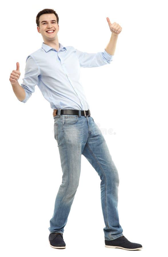 Homme montrant des pouces  image libre de droits