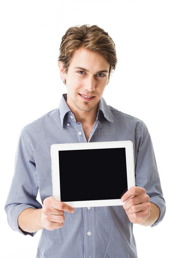 Homme montrant son écran de comprimé-PC photo stock