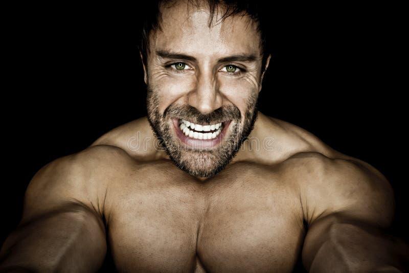 Homme musculeux fâché de culturisme photos libres de droits