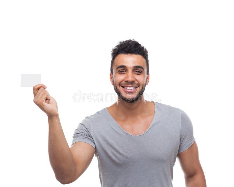 Homme occasionnel montrant le sourire heureux de conseil vide images stock