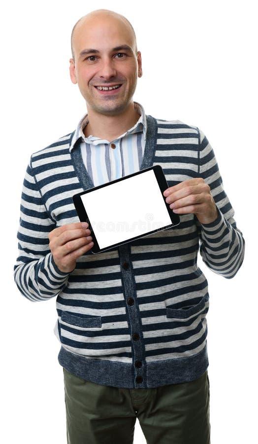 Homme occasionnel présent somenhing sur le comprimé numérique vide photographie stock