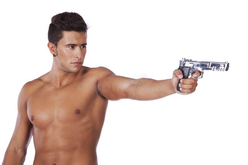 Homme orientant un pistolet photos libres de droits