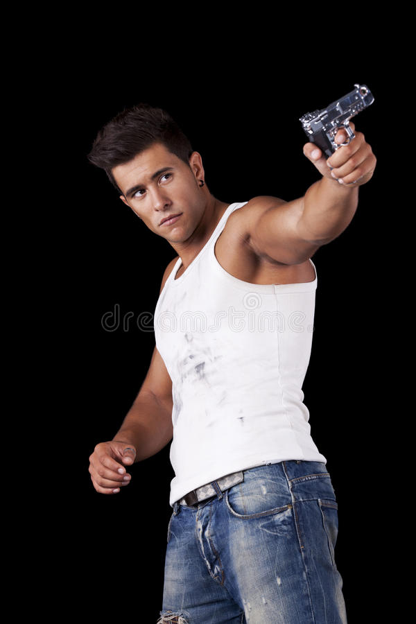 Homme orientant un pistolet photos stock