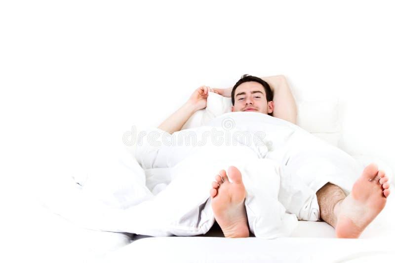 Homme paresseux images stock