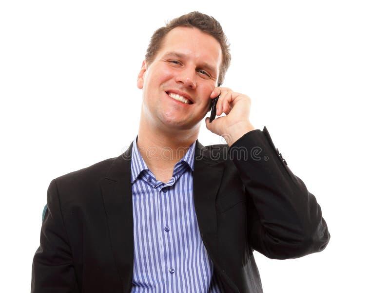Homme parlant de son mobile et sourire photographie stock