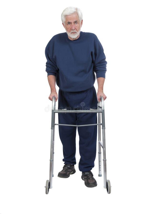 Homme plus âgé fâché avec Walker Isolated On White photo stock