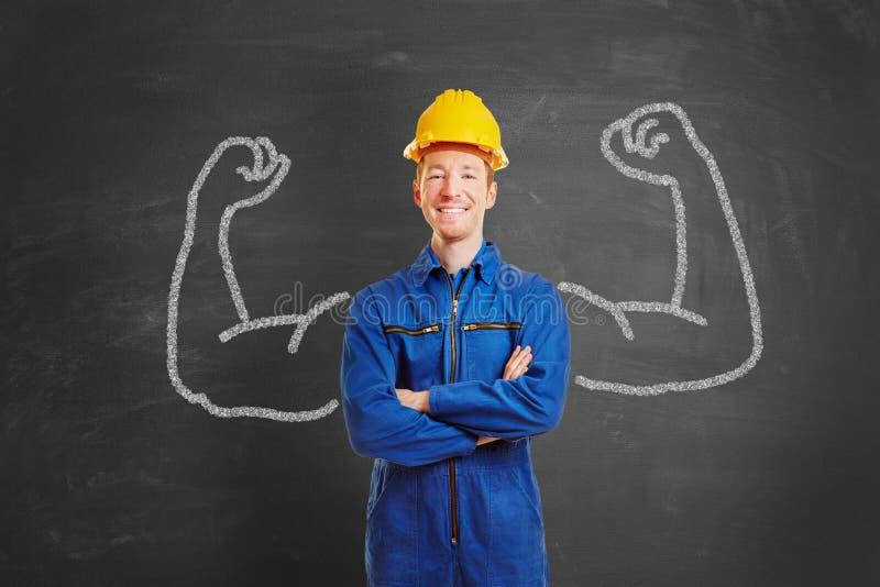 Homme puissant comme travailleur de la construction photographie stock libre de droits