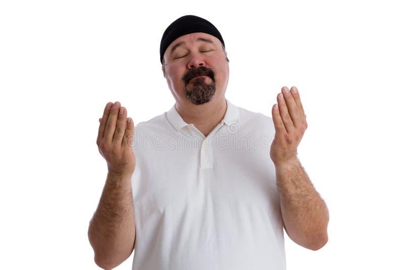 Homme religieux dévot profondément dans la prière photo libre de droits