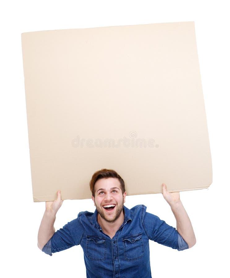 Homme retardant le signe vide d'affiche photographie stock