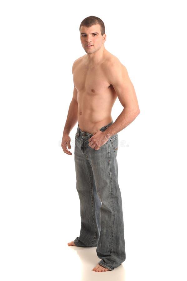 Homme sans chemise dans des jeans photos stock